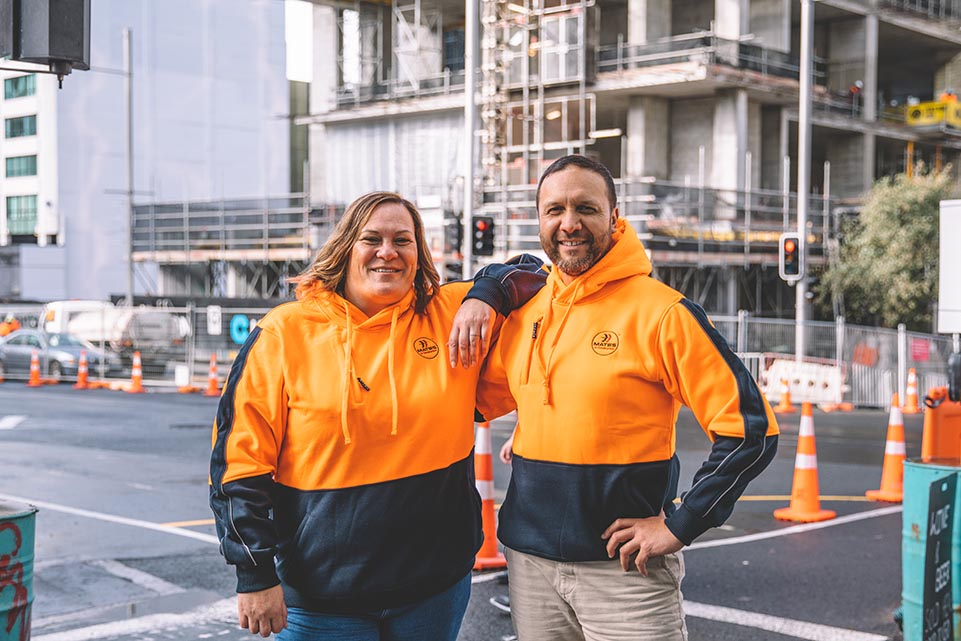 Ben and Erin MATES in Construction group photo for Web
